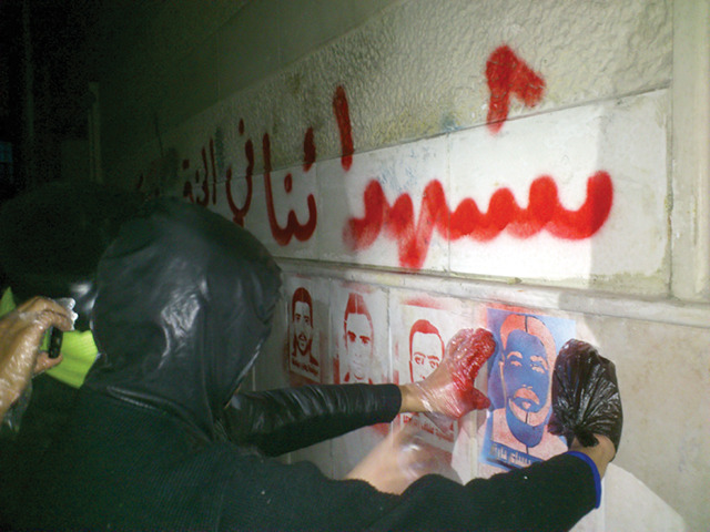 "THE WRITING IS ON THE WALL ANTI-REGIME ACTIVIST TAREK ALGORHANI TALKS ABOUT FIGHTING GUNS WITH CANS AND TAGS By Angelina Fanous   An anonymous activist who participates in the graffiti movement. When Tarek Algorhani walked out of a Syrian prison in June 2011, he had no idea that a revolution had erupted in his country—or that it had ignited over a cause he had been thrown in jail nearly six years for championing: inalienable human rights. In November 2005, Tarek and eight other bloggers founded Al Domary, a political site that used cartoons and other drawings to criticize the Syrian government and demand an end to the Assad regime. It quickly became one of the most popular anti-regime sites in the country. The Al Domary crew successfully used masked IP addresses and pseudonyms to evade the Syrian secret police until, three months after the site's launch, one of their bloggers was arrested, tortured, and forced to give up the location and identities of his comrades. The authorities shut down the site, confiscated their computers, and destroyed all files related to the operation. In February 2006, the bloggers were convicted of treason and each sentenced to five years, except for Tarek, who received nine because the authorities considered him to be the site's mastermind. Tarek was sent to Sednaya, a political prison 14 miles north of Damascus, where his jailers subjected him to marathon torture sessions. They stuffed him inside a tire, spun him around for hours, and beat him so badly he couldn't walk. ""We had prisoners who were moved from Abu Ghraib to Sednaya. They would cry at night, saying, 'I want to go back to Abu Ghraib,'"" he said. The dark prison cells were filthy, and some of the inmates' wounds became so infected that their legs had to be amputated. Escape was impossible; even if someone managed to sneak out, the surrounding desert was seeded with land mines. Five and a half years into his sentence, Tarek was pardoned for reasons he still doesn't understand. He returned to Damascus and discovered that a series of anti-regime demonstrations had begun. The thought of going back to prison didn't stop him from joining the movement, and he returned to agitation in no time, teaching activists how to shoot videos and upload them to YouTube. He kept detailed lists of the missing and killed to send to human rights groups, and established contacts to get first aid to anyone injured. Barely six months passed before Tarek once again became a wanted man—his name had been flagged at security checkpoints, and he was listed as an enemy of the state on official records. In January, he fled to Tunisia and began another human-rights internet project—this one centered around tagging anti-regime graffiti throughout the streets of Syria. In mid-October I called him up to ask how the fight was going. A paper stencil against a wall in Syria that reads: ""The Martyr Ahmed Asham."" VICE: What prompted you to use graffiti to push back against the regime?Tarek Alghorani: The revolution in Syria started because of graffiti. A small group of boys from Daraa watched the Egyptian and Tunisian revolution on TV, and they spray-painted the slogan ""the people want the regime to fall."" The Mukhabarat, the secret police, arrested them, tortured them, ripped out their fingernails, and that's when the rest of the country broke out in protests. At the beginning of the revolution, whenever people assembled, there were only a few of them. The police and security forces could easily split them up with no trace left behind. That's where the idea of drawings came in. Even if the police came in and dispersed people, anyone walking by later would know, ""There was a protest here, revolutionaries were here."" It's a stamp, a mark. And it's difficult for the police, because they get tired. Every time they would clean up a wall, something else would appear.What role do you play in this graffiti movement?In the beginning, activists would just quickly spray the walls with words and phrases like ""freedom"" or ""down with the regime,"" like the kids from Daraa, but it was rushed. I wanted to introduce an element of art to it, something to commemorate the martyrs we have lost in the revolution. Our goal is to use art to voice our concerns. In April, I started uploading videos on YouTube of how to spray-paint walls and put stencil drawings on Facebook for graffiti artists to use. Continue"