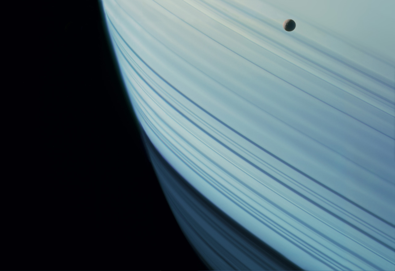 A gallery of sublime photographs from across our solar system This shot from Cassini, of Saturn's moon Mimas transiting the striped face of the gas giant, is just one of many breathtaking images collected for Michael Benson's soon-to-be-gracing-space-nerd-coffee-tables-everywhere book, Planetfall: New Solar System Visions. Time to update my Christmas list! (via io9)