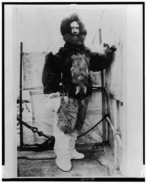 Robert Peary, full-length portrait, standing, facing front, in fur garments, taken between 1886 and 1909 after an expedition to the North Pole.