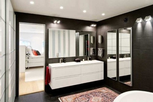 What a wonderful bathroom. I love the idea of a black bathroom, its so simple but creates a much warmer atmosphere then white.