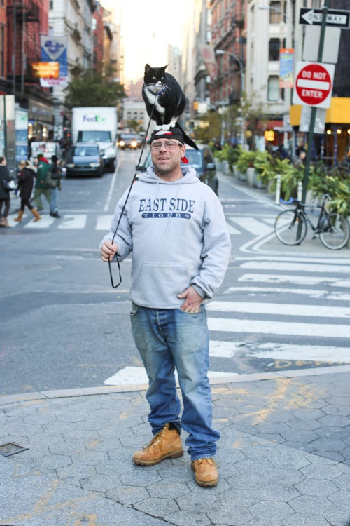humansofnewyork:  Great to see that Cat-On-Head Man came through the storm with cat still firmly on head.