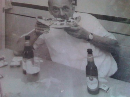 Ted's grandfather enjoying some pizza and a 'Gansett on Federal Hill during his lunch break from the butcher shop.