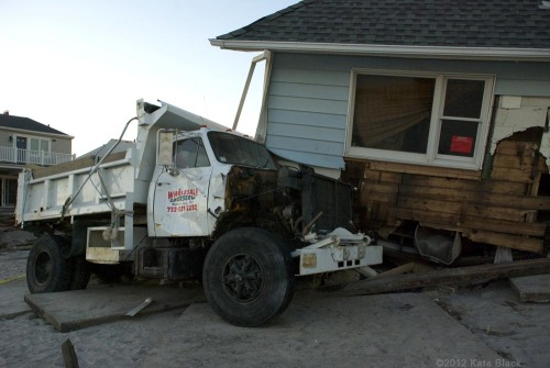 A house parked on top of a truck on the beach. Rockaway, Queens. November 6th, 2012.