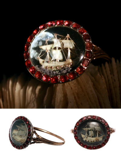 British Nelson Period Micro Ivory Ship Garnet Ring  Circa 1790, extremely rare survival of micro ivory rings. Set under crystal on hand painted waves with garnets surround. Similar ring can be found in The British Museum in London. Most likely English in origin although ivory hand carvings were done in Germany, France, and Switzerland in the late 18th century. Approximate 7.75 ring size. Can be sized.   $12,000.00 More beautiful rings can be found on Bell and Bird.