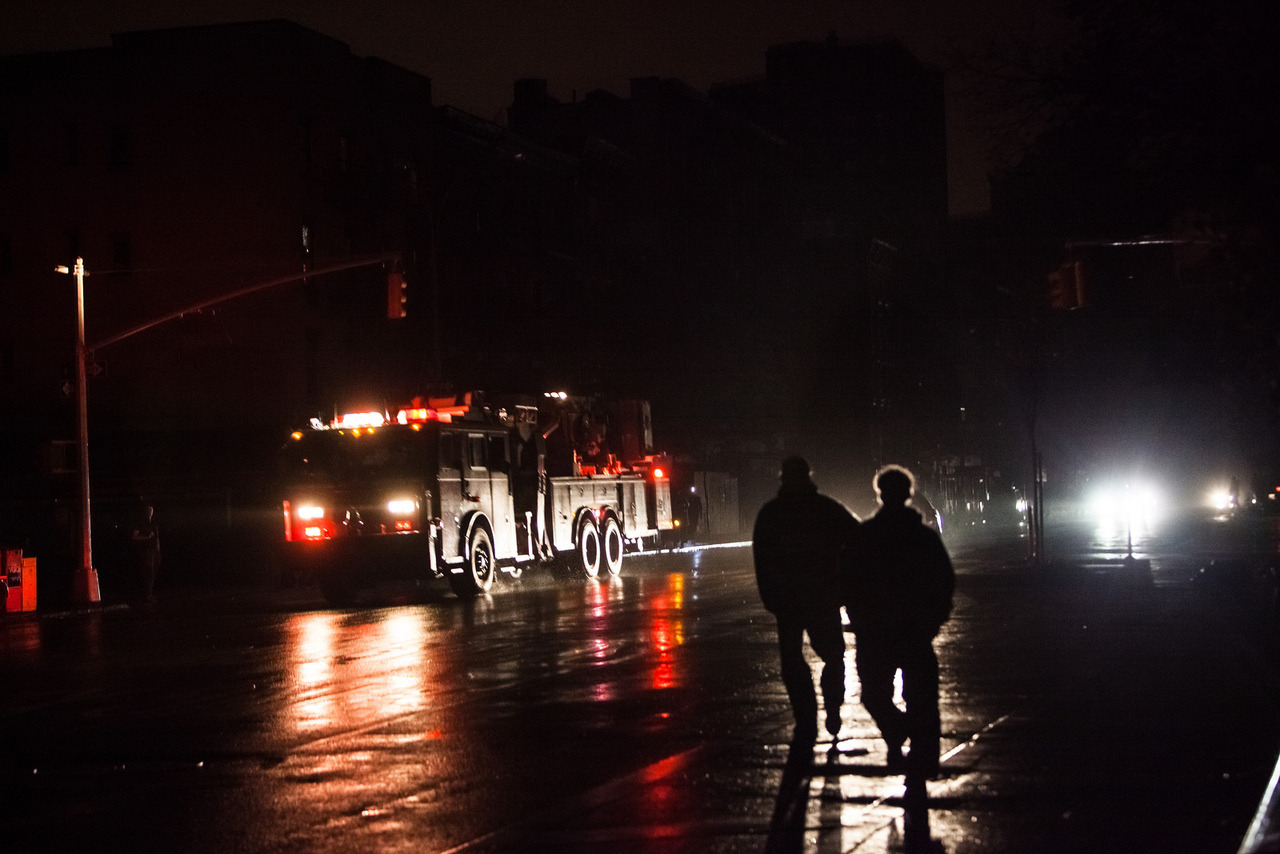 A NYFD truck races up First Avenue during Hurricane Sandy and after lower Manhattan's power goes out. Today Airbnb announced an initiative to connect those who were left homeless with those who are willing to offer free housing.
