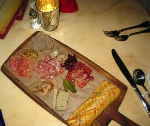 disneyfoodislove:  Charcuterie Plate with Pate, Sausages, Prosciutto, cornichons, Wine braised pearl onion jam, stone ground mustard and a toasted baguette from Be Our Guest Restaurant located in the New Fantasyland in Magic Kingdom.  The bread looks good tho
