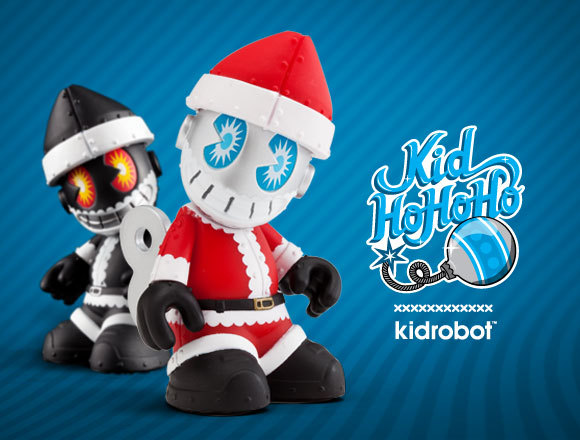 KidHoHoHo from Kidrobot Halloween was last week. And you know what that means? Time for Christmas ads. And Xmas-themed toys. Check out KidHoHoHo from Kidrobot. This mini mascot comes decked out in Santa gear, hat included. At he comes with a key lodged in his back, sort of like last year's Toy Soldier Android. Pick one up for $12 on November 15 and maybe you'll be lucky enough to open a coal colorway (1/10 rarity). Source: Kidrobot