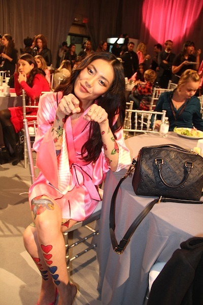 evachen212:  tattooed lady Liu Wen backstage at the Victoria's Secret show