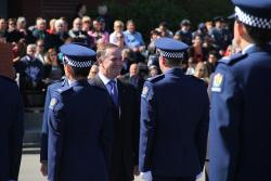 John Key looks at cops.