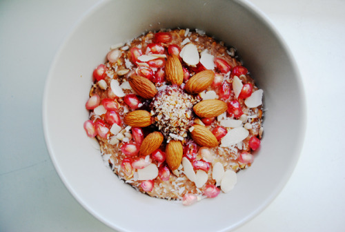 im-undone:  Big bowl of heaven: oatmeal with cocoa powder, strawberry jam, chopped walnuts, almonds, pomegranate, coconut shreds and sunflower seeds. Yummy!