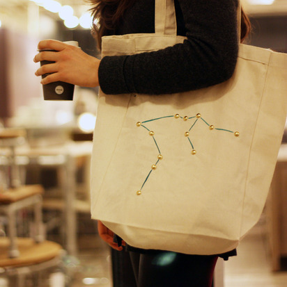 "DIY Studded Constellation Tote Tutorial from For The Makers here. If you aren't a member you cannot get their clipart for the zodiac/constellation guide templates, but google it and look under images for lots of options. *Tip: want to save money? Use office brads or scrapbook brads. You could even ""paint"" the brads with nail polish but I like the brass look. These would make cheap, practical and yet personal gifts."