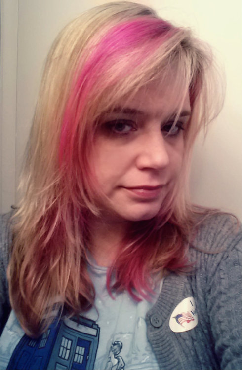 Cataloger Academic Library Michigan  Election Day: Pink hair, Doctor Who tshirt, grey cardigan.