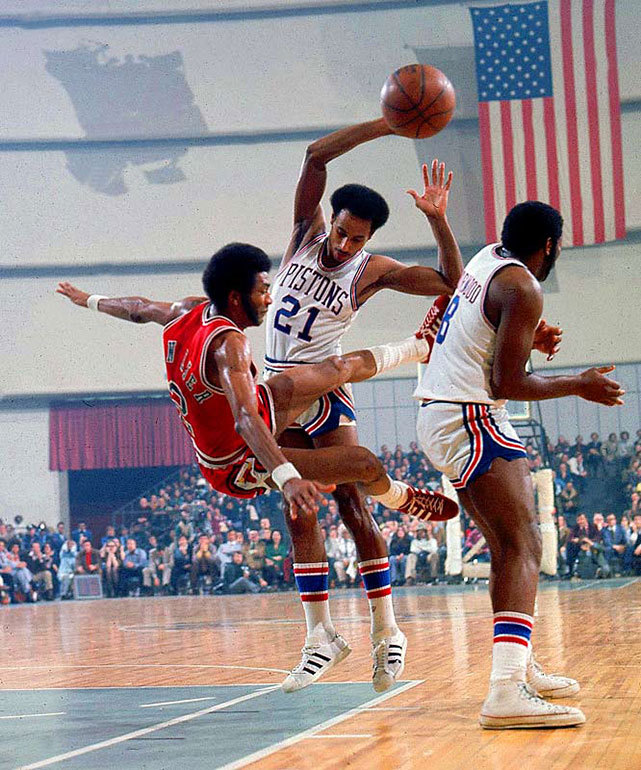 Norm Van Lier takes a charge from Dave Bing during a 1974 Bulls-Pistons game. (Lane Stewart/SI) GALLERY: Classic Photos of the Detroit Pistons