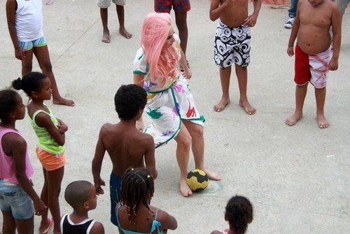 ladygagadaily:  Gaga playing football in Brazil few moments ago