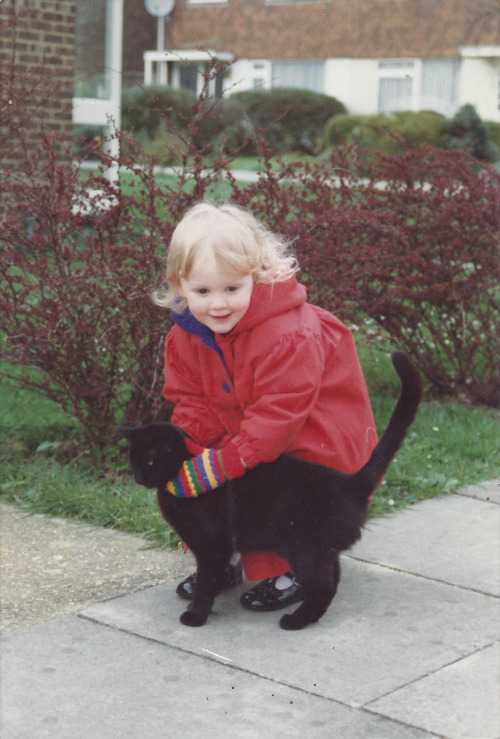 Me and one of our first cats, Wellington, circa twenty years ago.