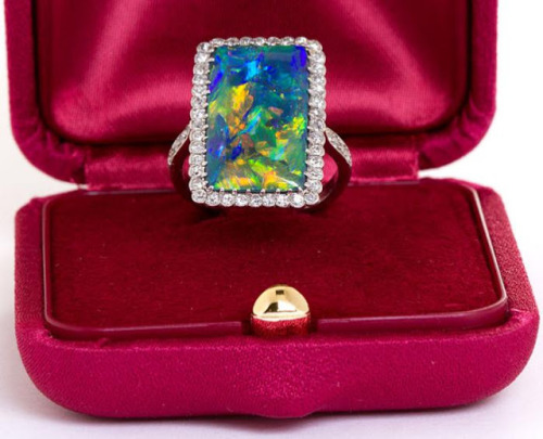 "diamondsinthelibrary:  ""Rarest"" Art Deco opal and diamond ring."