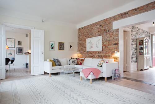 white and exposed bricks (via Keltainen talo rannalla)