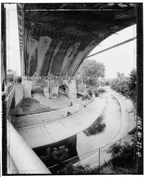 historicmke:  Detail view of arch spanning Menomomee river, looking west - Grand Avenue Viaduct, West Wisconsin Avenue, Milwaukee. Date: Unknown