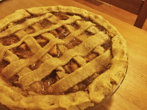 Peach Pie!  Ingredients For the crust: 2 cups white flour 1/2 tsp. baking powder 1 Tbsp. sugar, plus more for garnish 1 cup softened vegan butter 1/3 cup soy (or almond) milk 1/3 cup water For the filling: 4 large peaches, roughly diced 1/3 cup soy (or almond) milk 1 Tbsp. cornstarch 1/2 cup white sugar 1/2 cup maple syrup 1/2 tsp. cinnamon 2 tsp. vanilla extract Instructions In a large bowl. mix all ingredients for the crust with a potato masher until well combined.  Divide the dough into two balls and place one in the fridge. Using your fingertips, press the other ball into a pie dish, flattening the dough until it covers the dish. Bake at 350 F for 10 minutes. If you want to make this recipe even easier, try using a store-bought crust. Just make sure that it's vegan! :) In another large bowl, mix all ingredients for the filling until well combined. Pour evenly into the pie dish.  Remove the remaining dough from the fridge and flatten. Cut into strips with a butter knife and place over the pie filling. Sprinkle a little sugar on top and bake at 3350 F for 55 minutes.  Thanks!