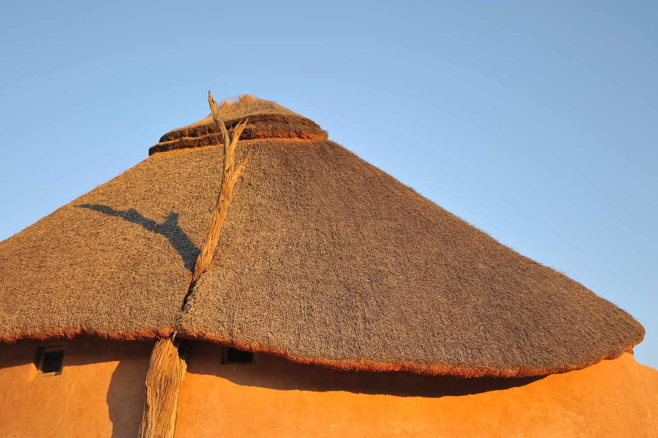 Travel Notes | Thatched rooftop. (Behind the scenes at the FW12 campaign featuring Daria Werbowy, shot on location in Kenya by Cass Bird)