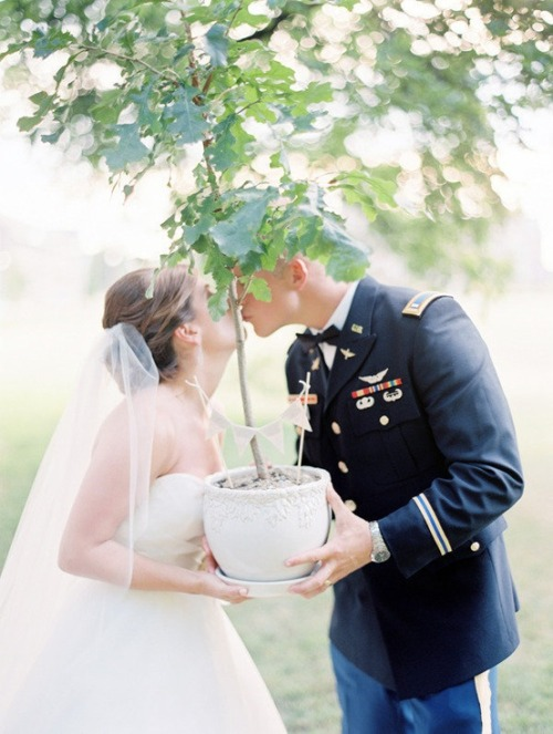 During the ceremony, this Bride and Groom planted an oak sapling with soil from all the places that had been important in their relationship.