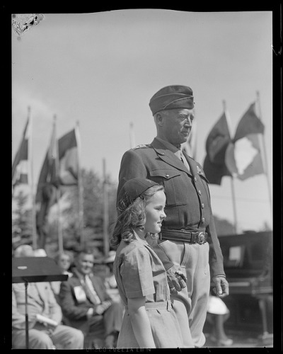 Gen. Patton holds the hand of a little girl in Hamilton, Mass. by Boston Public Library on Flickr.