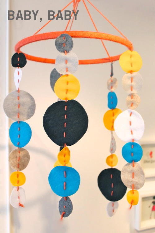 baby mobile made of modern felt circles embroidery hoop and yarn