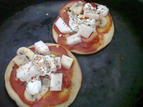 Vegan mini-pizza for breakfast (tomato sauce, soy cream, palm hearts, mushrooms, oregano, calabrian pepper and olive oil).  [Now this would get me up in the morning. - ed.]