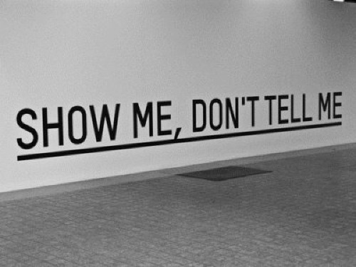 """Show, Don't Tell"" This short phrase represents one of the very most core distinctions between being a writer and being a great writer. The Big Idea: Maybe not everyone here is as big of an English nerd as I am, but have you even read a passage in a book that was so well written that it just sent a tingle down your spine? One that you had to stop reading for a second to just admire how perfectly it was worded? Or even a scene in a movie that is so well written it makes you sort of jumpy and you get that ""Yes! That makes perfect sense now!"" feeling. The kind that makes you so excited that you want to turn to someone and say ""Get it!? Because she said _____ in the beginning!?"" but of course everyone already gets it because the scene was just so flawless. Usually these are the passages where the author sums up a theme or where some major plot element ties together without the author directly telling you that it's being wrapped up. It's usually a passage that is heavy with symbolism and key words, one that links back to a previous moment of foreshadowing, or one that provides an important insight into a character. These moments wouldn't be as intensely satisfying if the author just came out and told you exactly what they meant, the reason they are so satisfying is because the author guides you, as the reader, into figuring it out for yourself. Obviously your story will not be all big reveal moments that need to be cleverly crafted but it will be important to sprinkle your novel with key words, clues, and the like that will help you better be able to show the reader later when your story eventually does come together. BUT: You should also be trying to incorporate this technique into your prose because overall, even for the mundane things, it is more fun to read when you have to deduce some of the elements for yourself. You don't want you just be telling your reader about what happens to the characters, you want them to be able to experience what is happening to the characters. You don't want to just tell them what is happening, you want to show them how it's happening. For example: 1. ""Maya was broke and burdened with debt. She knew she deserved a raise, after all she was the best barista in the whole coffee house.""  2. Maya expertly pressed espresso and steamed milk, pulling levers here and pouring streams of hot delicious beverages into ceramic mugs and paper cups there. The aroma of darkly roasted coffee swirling around her as she spun around the coffee counter like she was practicing a choreographed dance. She smiled as handed customers their beverages and wished them a good day, especially the sleepy or grumpy ones. It was a grey, gloomy day outside but she was sure her chipper attitude and the glorious caffeinated elixir they were about to partake in would be a much needed pick-me-up!When the morning rush died down and the regulars were all settled with their books and laptops sipping their chai lattes and cappuccinos, Maya untied her apron and leaned on the counter with her phone in her hands. She popped open her mobile banking app and scrolled through the recent transactions for a while then let out a tired sigh.An old man sitting on the couch furrowed his bushy brows and folded his newspaper, ""What's up buttercup? Student loan payments coming again?"" Maya looked up from her phone ""You know me Merv, always trying to make ends meet…"" He frowned a bit and said with a hint of derision ""Anthony still only paying you minimum wage, huh?"" Maya let out a short chuckle but just nodded.Merv got up and put a five in the tip jar before heading out, Maya smiled appreciatively and said to have fun at physical therapy. She tied her apron back up and began to sweep the floors, pausing only to glance up at her picture on the wall under the words ""Employee of the Month!""  In both options the next sentence or paragraph could still easily be an action that leads to your next plot point, but they are both very different approaches. The first example tells you that Maya is broke, that she needs a raise and that she is the best barista. Whereas the second example shows you how Maya is the best barista, it lets you discover for yourself that she is broke and then through dialogue leads you to the conclusion that she deserves a raise. You can see this is also and important distinction to make for NaNoWriMo because you can turn a 25 word leading sentence into 275 word chapter introduction while simultaneously making your story more interesting to read. Practice: This was a previous writing prompt we posted, it was also an exercise from one of my fiction writing classes in college and probably one of my most favorite writing exercise ever: http://writrs.tumblr.com/post/18519594456/ If you find yourself stuck on this concept take a break from writing and try the prompt! make sure you pay very close attention and stick to the rules! You can even use your MC from your NaNo novel instead of one of the characters on the list and if you end up liking it, add it to your word count! Good luck!-Camille"