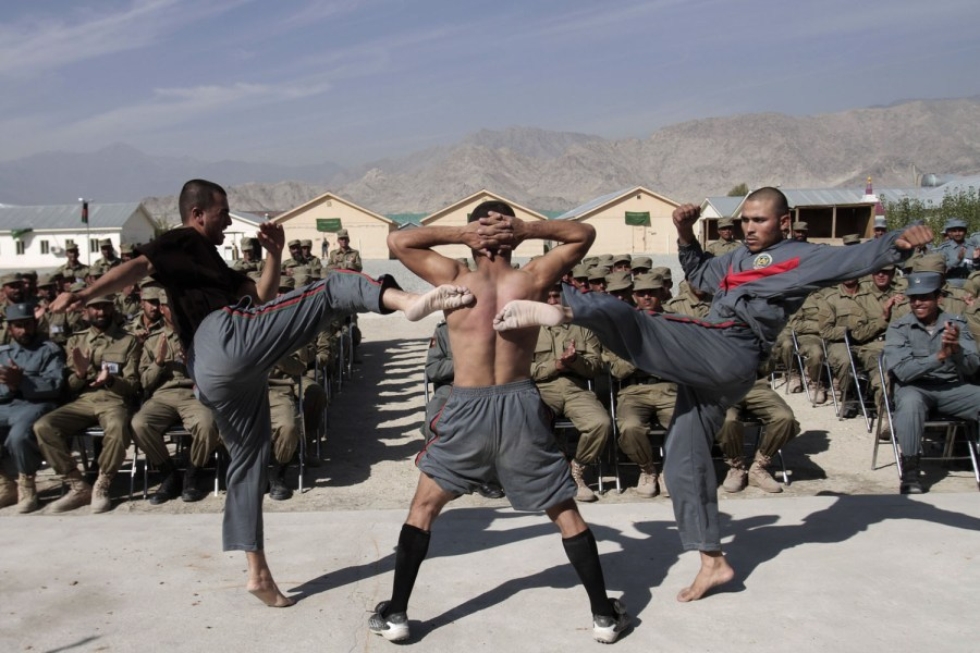 timelightbox:  Nov. 7, 2012. Newly graduated Afghan police officers demonstrate their skills during a graduation ceremony at a National Police training center in Laghman province, east of Kabul. (photo: Rahmat Gul—AP)  From President Obama's reelection and Superstorm Sandy's aftermath to a deadly earthquake in Guatemala and a train cemetery in Bolivia, TIME presents the best photographs of the week. See more photos here.