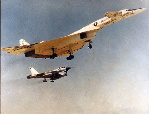 North American XB-70A Valkyrie in flight landing configuration, with Convair B-58A flying chase. Note the blotched appearance is due to the white paint being flaked and burned off during the high speed flight portion of the test. (U.S. Air Force photo)