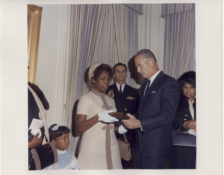 Accepting his honor On December 2, 1969, the widow of Army Staff Sergeant Clifford Sims accepted the Medal of Honor on her husband's behalf from Vice President Spiro Agnew. SSG Sims was killed when he threw himself on a booby-trap as it exploded, saving the lives of his fellow soldiers.  Photograph of Spiro Agnew Posthumously Awarding Medal of Honor to Staff Sergeant Clifford C. Sims, 12/02/1969  via DocsTeach