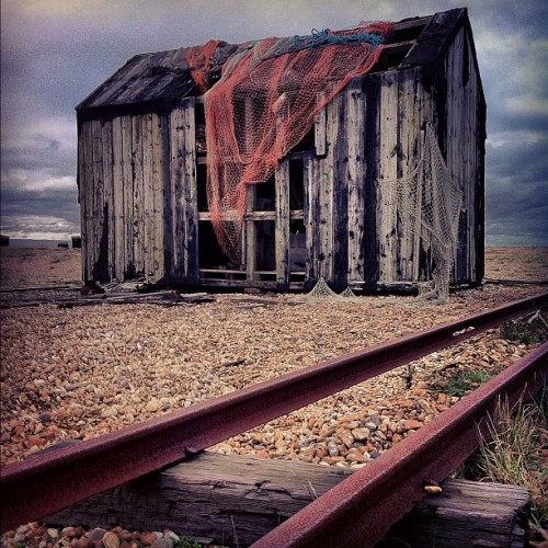 Derelict shack by the sea (at Dungeness Lighthouse)