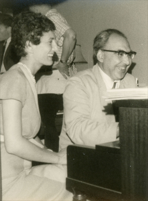"Halmos photographed Natalie Davis and Alfréd Rényi (1921-1970) in August of 1961. Natalie Zemon Davis, wife of mathematician Chandler Davis, is a noted social and cultural historian, primarily of early modern France. Her best known book is The Return of Martin Guerre (1983), also the title of a popular film released at the same time. Natalie and Chandler Davis were victims of the ""Red scare"" in the United States during the 1950s, with Chandler Davis losing his job at the University of Michigan in 1954 and even being imprisoned for six months. They moved to Toronto, Canada, in the early 1960s, at about the time this photograph was taken. Chandler Davis is now Professor Emeritus of Mathematics at the University of Toronto (Wikipedia, University of Michigan History, University of Toronto Mathematics) Born in Budapest, Hungary, Alfréd Rényi earned his doctoral degree in 1945 from the University of Szeged, Hungary, under advisor Frigyes (Frédéric) Riesz. According to O'Connor and Robertson of the MacTutor Archive, this was after graduating from the University of Budapest, where he studied from 1940 to 1944 under Lipót Fejér and Paul Turán, escaping from a forced-labor camp, hiding out to avoid capture, and rescuing his parents from the Budapest ghetto by impersonating a soldier. After a postdoctoral year in Russia (1946-47) during which he obtained important results on the Goldbach Conjecture, Rényi continued to obtain results in number theory, probability, and analysis as a professor at the University of Budapest and a member of the Hungarian Academy of Sciences and director of its Institute for Applied Mathematics before dying suddenly at age 48. Rényi's wife was the mathematician Katalin (Kató) Rényi, and possibly she and/or Chandler Davis were among the assembled party as well. We will search for photographic evidence! (Source: MacTutor Archive)  Who's That Mathematician? Images from the Paul R. Halmos Photograph Collection"