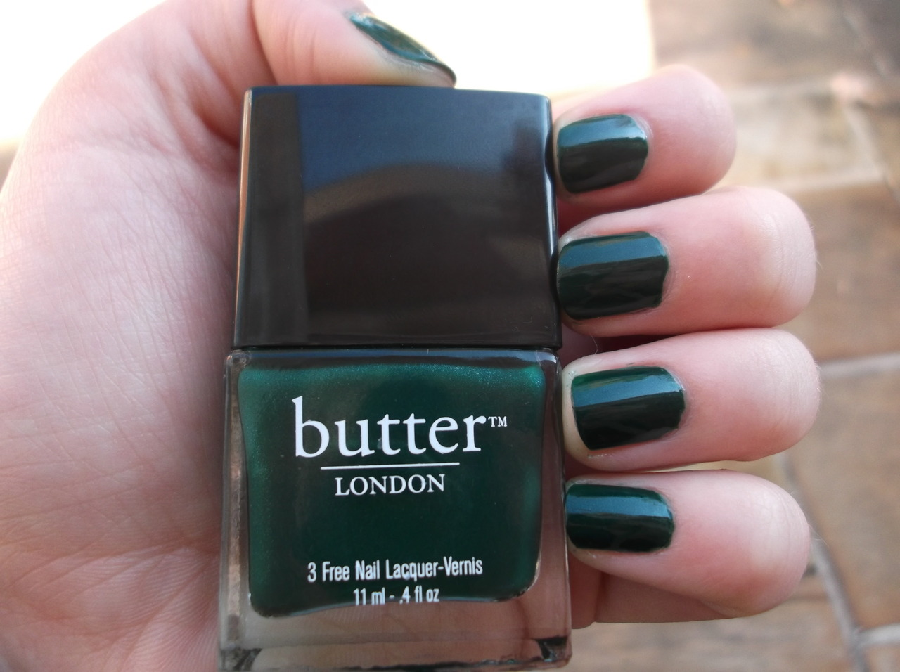 Today's Nails: Butter London // British Racing Green This is the last polish from my mildly excessive Butter London Haul back in September. My material soul had been longing for this frosty, dark forest green polish every since I saw it mentioned in a beauty video last fall, and I finally let myself get it at the 2-for-1 Ulta sale. After I brought it home, I wasn't sure about my purchase, and it took me a long time to try it out on my nails. But when I wore it for the first time last week, I fell in love all over again. The shimmer is unnoticeable unless you're in direct sunlight, and it only makes the polish look even more festive. It's dark, beautiful, and 100% seasonally appropriate. I kind of just want to wear it forever. Excellent application, opacity and overall quality, as to be expected of BL polishes.