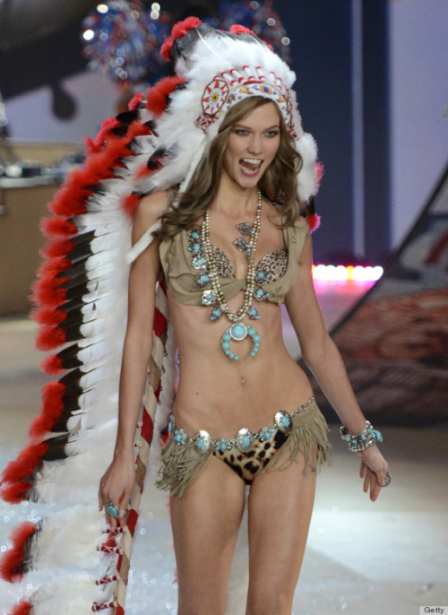 Wearing a leopard print bikini, Kloss did her famous strut down the runway with some pretty hefty accessories: layers of turquoise jewelry and some lucite, fringe-covered heels. But the towering Native American-style headdress on her head is sure to get the most heat. (Have we learned anything from Paul Frank's ill-advised Fashion's Night Out party?)  High profile problem lately.