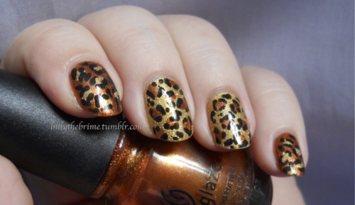 billythebrime:  Nothing fancy, just some fun metallic leopard print. You can't really go wrong with some leopard print nails. When I finished, I realized that the gold based nails looked super similar to my Mom's nail strips she wore with her crazy cat lady costume on Halloween.  Not bad. Colors Used: Milani 3D Holographic- 3D China Glaze- Harvest Moon Sinful Colors- Black On Black