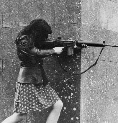 cheesecrackerdevice:   A female IRA fighter armed with an AR-18 taking aim at Pro-British troops during skirmishes. County Armin, Northern Ireland, 1972.  My dad said the IRA used to be so good. He's kind of a radical about that stuff