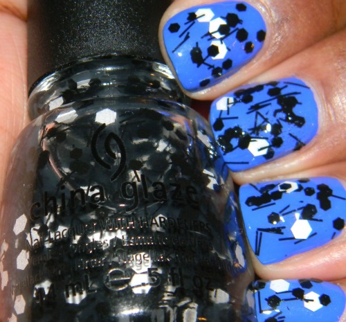 China Glaze - Whirled Away from the Cirque du Soleil Collection For this manicure I started off with two coats of Essie - Butler Please which is now my favorite blue creme. Whirled Away consists of large white hex, black strings, and medium sized hexes. To get the white hexes on I had to use the brush to dab them on. I went a little dab crazy on my middle finger which caused air bubbles as you can see.  Fin.