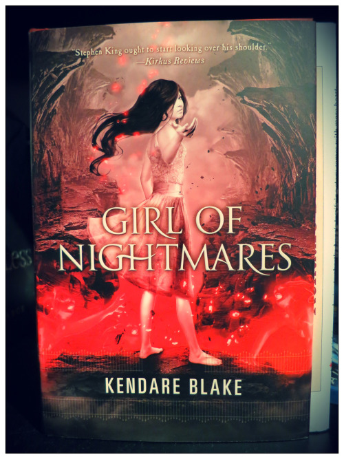 "cinderellainrubbershoes:  REVIEW: Girl of NightmaresAuthor: Kendare BlakeGenre: Young Adult, Horror, ParanormalMy Rating: ★★★★ (4/5 stars) ___ ""I'd go through hell for you"" is perchance one of the most hackneyed declarations of true love a person could ever concoct. But no matter how many layers of oozing cheese were dabbed on it, you got to admit that the volumes it speaks are not subdued one bit. Nothing beats the classic ""I'll do anything for you."" What more if someone means this literally? That's practically the premise of Kendare Blake's Girl of Nightmares. The novel picks up right where Anna Dressed in Blood left off, centering on teenage ""ghost hunter"" Cas Lowood. Anna Korlov, the homicidal ghost whom Cas fell in love with, opened a gate to Hell so she could drag the baleful Obeahman into it to save Cas and his friends. Months after the incident, Cas is continually haunted by images of a tortured Anna both when he's asleep and when he's awake. He will not be at peace as long as Anna isn't, and he'll do anything to pull her back. But Anna is already dead, and the world Cas lives in belongs to the living. Is he doing the right thing? Is it worth letting the new world he built around himself crumble, letting his loved ones down all for the sake of a ghost who had her share of murders?Amidst all the chaos going on in his life, there are a few things Cas is very sure of: that he loves Anna more than anything, and he's going to save her no matter what.With Girl of Nightmares, Blake spun a tale of ""rescue the not-quite-damsel-in-distress"" as a sequel to what was billed as her ""average boy-meets-girl, girl-kills-people"" story. Cas might have taken the spotlight solo this time, but the story never makes bones about the fact that the plot still banks on romance, though not as heavily as did its predecessor. Even if Anna is absent for the most part of the story, Blake managed to make it as though she's there all the time, her presence heavy and ominous.Cas as a character hasn't changed much. He still has that inner sarcasm factory inside him functioning every waking hour, his cynicism and superiority complex still his biggest features, and he still irks himself for being the miserable, lovelorn guy that he's become. Despite all these, he's surprisingly easy to like as a narrator. I think it's because Blake made it so that his thought processes are bluntly honest and often hilarious. It's not often that the readers are let into the mind of a character with zero walls to guard what other writers would rather keep behind closed doors.I loved how in the few chunks of Anna moments near the end, she proved that she would not fit into the mold of princesses who needed someone else to save them. One character comments something to the effect of ""You gotta act, we don't need damsels-in-distress here."" Anna merely smirks and shows what she is really made of, fighting in the way she only knows how…after being burned, stabbed, broken, and exposed to several other kinds of torment. The plot is thankfully not dual in nature like that of Anna Dressed in Blood. Be that as it may, I liked the subplots that branched out, including the realistic repercussions of Carmel being catapulted from the high school Queen Bee to a ghost-buster team tagalong, how Cas dealt with everybody thinking he's a special case of emo kid gone mental, and how the secrets of the Order of the Biodag Dubh are revealed. I find the new characters enticing as well; Jestine is admittedly annoying in her first appearances, but I gradually grew fond of her. Oh, and I think I love Aunt Rikka and her gingersnaps (those who've read it would understand).I guess what really took the cake are the author's palpable descriptions. This is kind of hard to do when you're speaking through the mouth of a boy who has no time for pretty words, but Blake pulled it off perfectly. She is able to deftly create what she wanted the readers to see and feel. She brings to life gory and bloody scenes, textures you'd shudder to feel, and scent you'd crinkle your nose at. Watch out for the scenes in the museum and the Suicide Forest. If you have an exceptionally overactive imagination, I don't recommend reading the latter at night. There is a big possibility of robbed sleep.The story was carefully paced; it's not slow to a point that you'll be get wrapped with ennui, but it's also not fast that there's no room for the other story elements to develop.I became a tad emotional when I reached the part I consider the climax. And it's not when they're combating the Obeahman in Hell; it's when Cas has to make the ultimate decision regarding Anna. He'll consider it a wild goose chase if he's selfish, but what I can say—love does unspeakable things to people. I wept a little at the end.Girl of Nightmares is a wildly unforgettable romp about love that transcends death, of unselfish devotion in the most dire of consequences. Four stars for an amazing read."