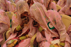 diamonds-wood:  Nov. 4, 2012. Indian Muslim brides chat as they wait for the start of a mass wedding ceremony in Ahmedabad. Sam Panthaky—AFP/Getty Images  my birthday