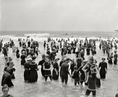 ca 1910 Bathers at Atlantic City, The Jersey Shore, NJ, USA; many of them gamely striking a pose for the camera as they peer into the existential void via