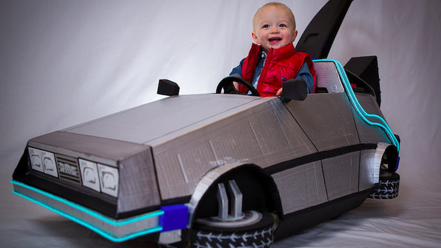 Awesome Baby's Marty McFly Costume and DeLorean Push CarClick here for more pics: http://gizmodo.com/5955110/this-awesome-babys-marty-mcfly-costume-and-delorean-push-car-is-absolutely-adorable