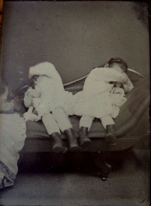 ca. 1860-1900's, [tintype portrait of two shy young girls, clutching their dolls and hiding their faces] via Ebay