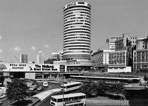 The Rotunda, Birmingham, England (circa 1978). Designed by James A. Roberts, The Rotunda opened in 1965 as a 25 storey, cylindrical office building. Commercially, it was a failure as it proved difficult to let, however the building became iconic amongst locals and when proposals were put forward in the 1980s and 1990s for its demolition, local opposition was considerable. In light of this, the building was designated Grade II listed status in 2000. From 2004 to 2008, The Rotunda was stripped back to its bare frame, and renovated into apartments, designed by Glenn Howells Architects.