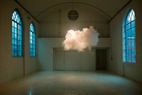 That's not Photoshop. The Dutch artist Berndnaut Smilde has developed a way to create a small, perfect white cloud in the middle of a room. It requires meticulous planning: the temperature, humidity and lighting all have to be just so. Once everything is ready, Smilde summons the cloud out of the air using a fog machine. It lasts only moments, but the effect is dramatic and strangely moving. It evokes both the surrealism of Magritte and the classical beauty of the old masters while reminding us of the ephemerality of art and nature. Super neat! I want to see it. :)