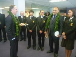 John Key looks at school girl.