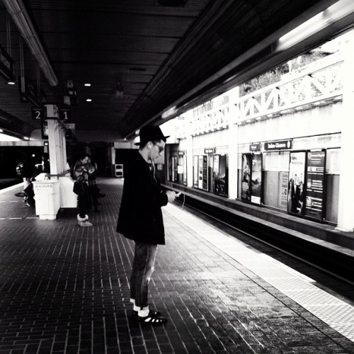 The Man with the Black Hat #man #stations #platforms #strangers #others #commute #transit #trains #lightanddark #meian #city #urban #blackandwhite