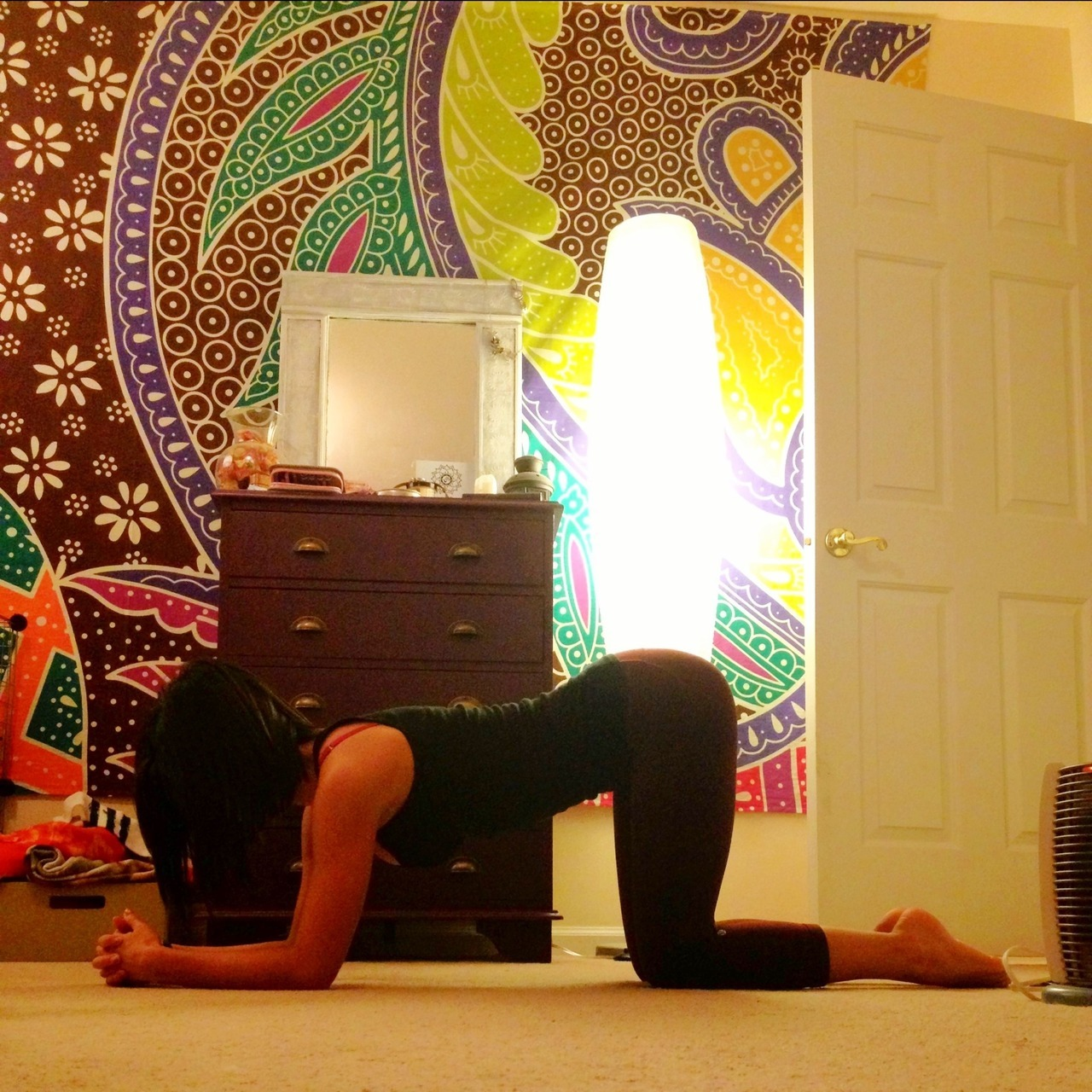 upinthe-air:  As requested, a headstand step by step!  This is how I learned and its the first inversion I learned (besides shoulder stand). First things first, make sure your elbows are shoulder width apart, and the cup your head in your hands. You should be positioned on the crown of your head, but your weight will be supported on your arms. Once you're comfortable, push into downward dog and walk your toes as close to your elbows as possible. You can spend a couple breaths here. Bringing one knee in at a time, with a teeny tiny kick, lift yourself into a little pod. I used to stay here for as long as possible while I was learning so I could get used to balancing. When you're ready, begin straightening the legs. Make sure you stack ankles on top of hips on top of shoulders. It helps to tuck the tailbone in. This will also help with the balance. As you get stronger in the posture you can then try lifting, instead of kicking, with straight legs right off the floor.