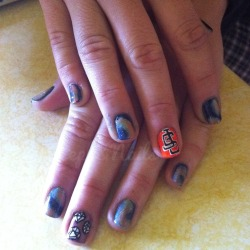 sister's nails with galaxy, diamonds, and sf giants